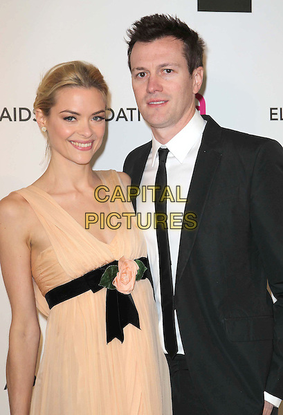 Jaime King & Kyle Newman.21st Annual Elton John Academy Awards Viewing Party held at West Hollywood Park, West Hollywood, California, USA..February 24th, 2013.oscars half length orange pink peach dress black waistband sheet sleeveless slit split black suit white shirt tie couple .CAP/ADM/KB.©Kevan Brooks/AdMedia/Capital Pictures.