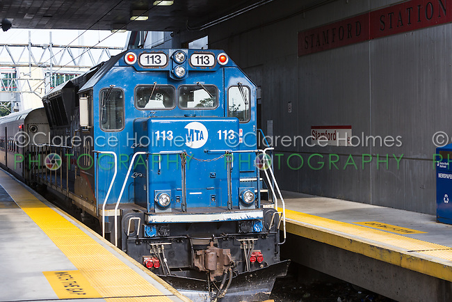 An Metro-North BL20GH diesel locomotive waits with its train in Stamford Station in Stamford, Connecticut.