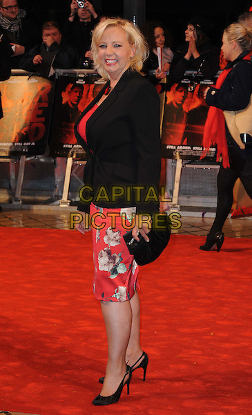 "DEBORAH MEADEN.Attending the ""Red"" UK film premiere, Royal Festival Hall, Southbank Centre, .London, England, UK,.19th October 2010..full length black jacket red print dress slingbacks shoes clutch bag side smiling  side .CAP/WIZ.© Wizard/Capital Pictures."