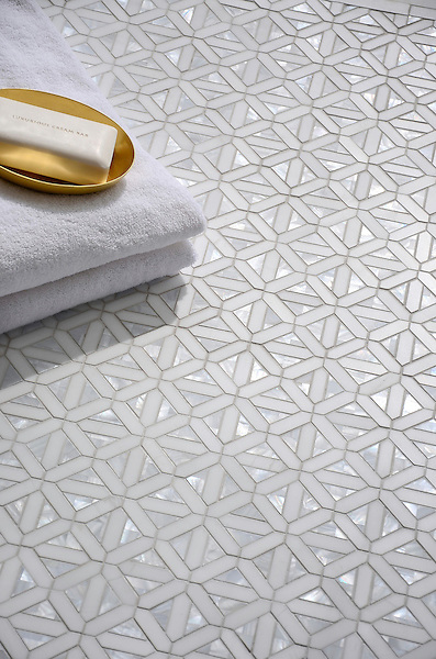 Joie, a handmade mosaic shown in polished Dolomite and Shell, is part of the Studio Line of Ready to Ship mosaics.<br />