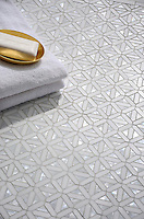 Joie, a handmade mosaic shown in polished Dolomite and Shell, is part of the Studio Line of Ready to Ship mosaics.<br /> <br /> For pricing samples and design help, click here: http://www.newravenna.com/showrooms/