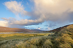 Isle of Lewis and Harris, Scotland: Clearing storm clouds and rainbow over the dune grasses near Luskentyre beach on South Harris Island