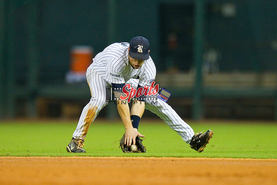 Second baseman Michael Ratterree #8 of the Rice Owls fields a ground ball against the Texas A&M Aggies at Minute Maid Park on March 5, 2011 in Houston, Texas.  Photo by Brian Westerholt / Four Seam Images