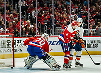 WASHINGTON, DC - JANUARY 31: The puck slips past Braden Holtby #70 of the Washington Capitals for the first Islander goal during a game between New York Islanders and Washington Capitals at Capital One Arena on January 31, 2020 in Washington, DC.
