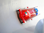 15 December 2007: Italy 2 pilot Fabrizio Tosini with brakeman Danilo Santarsiero exit a turn during their first run at the FIBT World Cup Bobsled Competition at the Olympic Sports Complex on Mount Van Hoevenberg, at Lake Placid, New York, USA. ..Mandatory Photo Credit: Ed Wolfstein Photo