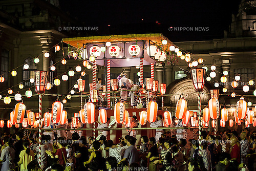 People dance in a circle to the sound of a traditional Japanese taiko drum performance at the ''Noryo-bonodori'' or Bon Dance Festival at Tsukiji Honganji Temple on July 29, 2015, Tokyo, Japan. The annual event is one of the most popular Bon Odori festivals in Tokyo, and is held from July 30 to August 2. (Photo by Rodrigo Reyes Marin/AFLO)