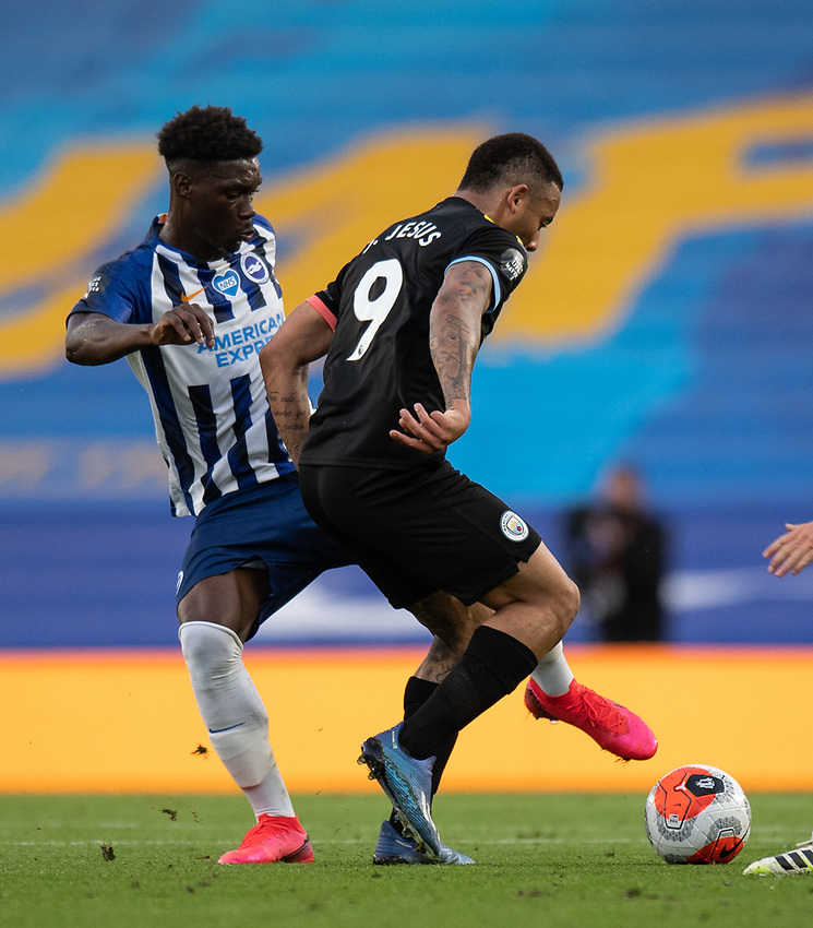 Brighton & Hove Albion's Yves Bissouma (left) battles with Manchester City's Gabriel Jesus (right) <br /> <br /> Photographer David Horton/CameraSport<br /> <br /> The Premier League - Brighton & Hove Albion v Manchester City - Saturday 11th July 2020 - The Amex Stadium - Brighton<br /> <br /> World Copyright © 2020 CameraSport. All rights reserved. 43 Linden Ave. Countesthorpe. Leicester. England. LE8 5PG - Tel: +44 (0) 116 277 4147 - admin@camerasport.com - www.camerasport.com