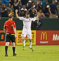 CARSON, CA – August 20, 2011: LA Galaxy forward Robbie Keane (14) celebrating his goal during the match between LA Galaxy and San Jose Earthquakes at the Home Depot Center in Carson, California. Final score LA Galaxy 2, San Jose Earthquakes 0.