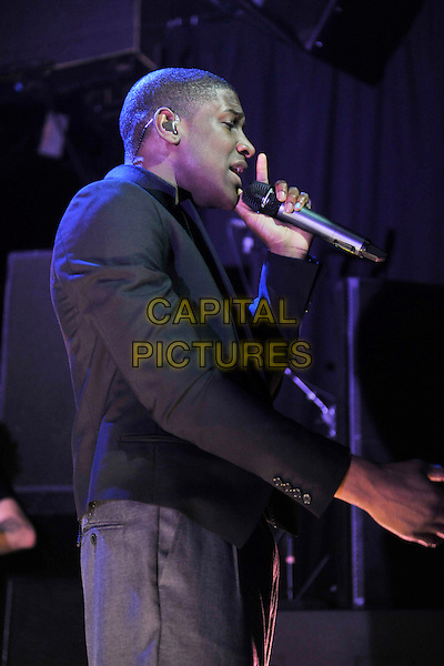LABRINTH (Timothy McKenzie).Labrinth performing live at Koko, London, England..November 30th, 2010.stage concert live gig performance music half length black suit jacket grey gray trousers singing profile .CAP/MAR.© Martin Harris/Capital Pictures.