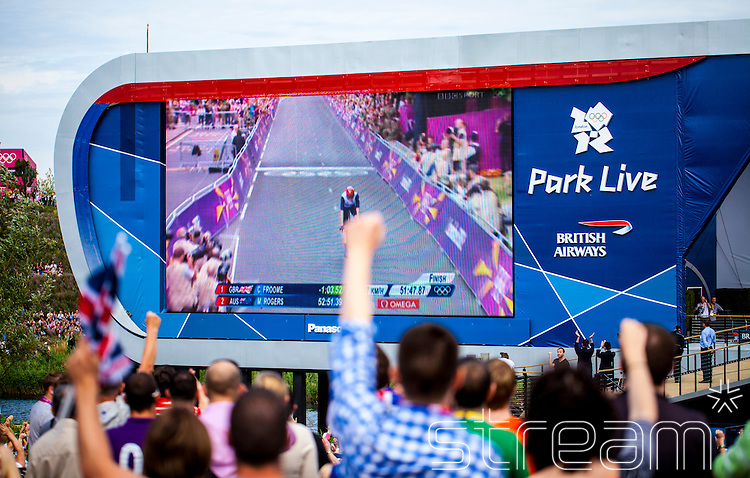 Crowd celebrate as they watch a GB cyclist during the time trials on the big screen at the Olympic Park London 2012.