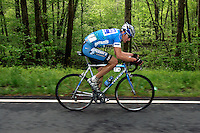 Jason McCartney, of the Discovery Channel Pro Cycling Team, rides a solo breakaway during Stage 5 of the Ford Tour de Georgia. His teammate Tom Danielson won the 94.5-mile (152.1-km) stage from Blairsville to the top of Brasstown Bald, the highest point in the state. McCartney finished 18th.<br />
