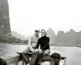 CHINA, Guilin, portrait of smiling young couple traveling on a boat on the Li River (B&W)