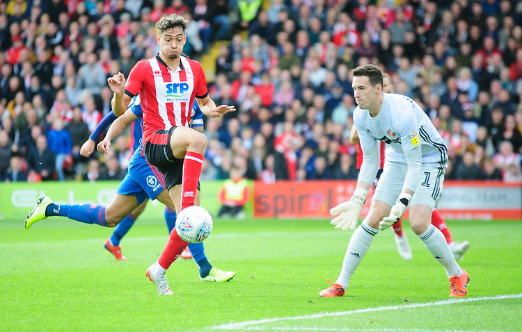 Lincoln City's Tyler Walker lifts the ball over Sunderland's Jon McLaughlin to score the opening goal<br /> <br /> Photographer Andrew Vaughan/CameraSport<br /> <br /> The EFL Sky Bet League One - Lincoln City v Sunderland - Saturday 5th October 2019 - Sincil Bank - Lincoln<br /> <br /> World Copyright © 2019 CameraSport. All rights reserved. 43 Linden Ave. Countesthorpe. Leicester. England. LE8 5PG - Tel: +44 (0) 116 277 4147 - admin@camerasport.com - www.camerasport.com