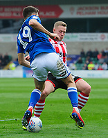 Lincoln City's Danny Rowe vies for possession with Macclesfield Town's James Pearson<br /> <br /> Photographer Chris Vaughan/CameraSport<br /> <br /> The EFL Sky Bet League Two - Lincoln City v Macclesfield Town - Saturday 30th March 2019 - Sincil Bank - Lincoln<br /> <br /> World Copyright © 2019 CameraSport. All rights reserved. 43 Linden Ave. Countesthorpe. Leicester. England. LE8 5PG - Tel: +44 (0) 116 277 4147 - admin@camerasport.com - www.camerasport.com