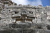Carving of the god of rain, Chaac with the symbol of corn (¤) above the mask, The Astronomical Observatory, called El Caracol (Snail) because of the spiral staircase inside it, Toltec architecture, 900-1100 AD, Chichen Itza, Yucatan, Mexico. Picture by Manuel Cohen