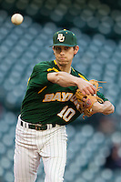 Baylor Bears starting pitcher Austin Stone #40 makes a pickoff throw to first base against the Houston Cougars in the NCAA baseball game on March 2, 2013 at Minute Maid Park in Houston, Texas. Houston defeated Baylor 15-4. (Andrew Woolley/Four Seam Images).