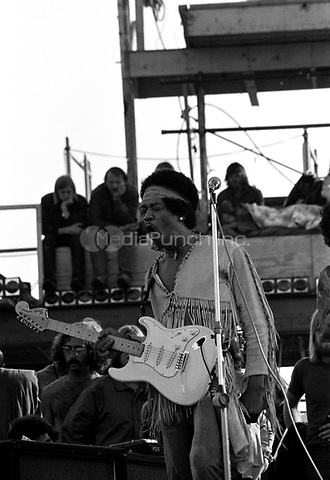 Jimi Hendrix performing his legendary 2 hour performance at Woodstock Music & Arts Festival held on Sam Yasgur's alfalfa field in Sullivan County in Bethal, New York on August 18, 1969. Hendrix insisted he close the festival and was scheduled to appear at midnight but due to delays did not take the stage until 9 am Monday morning. Most of the crowd had left for home by then and had dwindled from a whopping 500,000 to measly 80,000. ** HIGHER RATES APPLY ** CALL TO NEGOTIATE RATE ** © Peter Tarnoff / MediaPunch