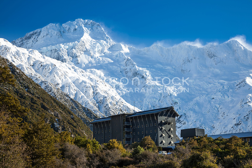 Mt Sefton towers above the Hermitage Hotel, Aoraki Mt Cook Village NZ.  Available as stock download, canvas print and fine art print.