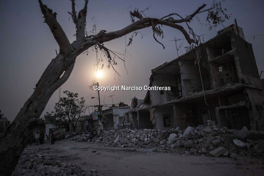 House buildings shattered by aircraft shelling remain in a civilian neighborhood after several days of rough battles between rebel forces and the Syrian army to take control of the Azaz city.