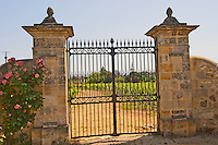An iron gate and stone gate posts inscribed with ausone to the vineyards of Chateau Ausone  Saint Emilion  Bordeaux Gironde Aquitaine France