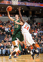 Nov. 12, 2010; Charlottesville, VA, USA;  William & Mary Tribe g-f Quinn McDowell (20) shoots in front of Virginia Cavaliers guard K.T. Harrell (24) during the game at the John Paul Jones Arena.  Mandatory Credit: Andrew Shurtleff