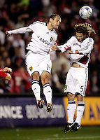 Real Salt Lake forward Yuri Movsisyan (14) and midfielder Kyle Beckerman (5) head the ball out of danger.  Real Salt Lake defeated the Chicago Fire in a penalty kick shootout 0-0 (5-4 PK) in the Eastern Conference Final at Toyota Park in Bridgeview, IL on November 14, 2009.