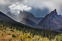 Dramatic clouds over Elephants tooth (right) and Parabala mountain (left), Arrigetch Peaks, Gates of the Arctic National Park, Alaska.