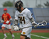 Brennan O'Neill #34 of St. Anthony's looks to maneuver for a shot during the Nassau-Suffolk CHSAA varsity boys lacrosse Class AA final against Chaminade at Mitchel Athletic Complex on Tuesday, May 15, 2018. The game went to halftme tied 8-8 when a prolonged lightning storm forced a postponement.