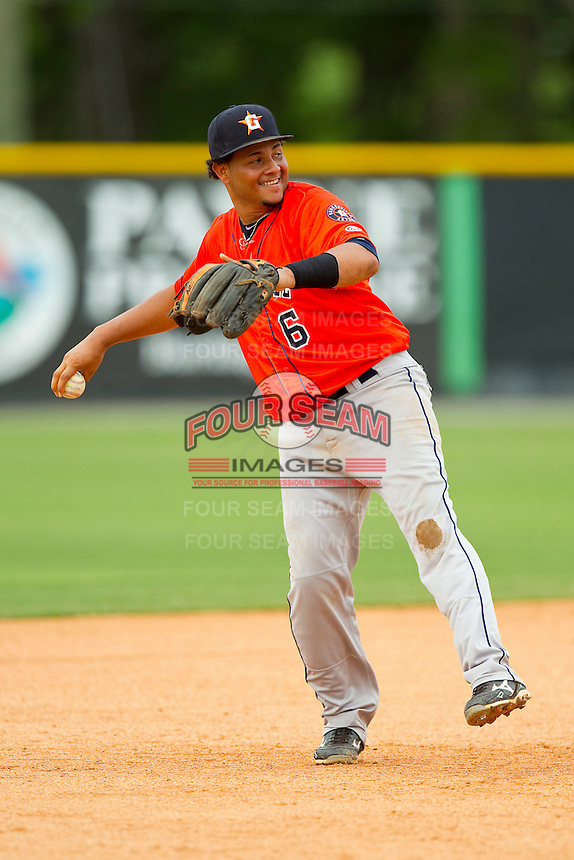 Greeneville Astros third baseman Darwin Rivera (6) warms up between innings of the Appalachian League game against the Burlington Royals at Burlington Athletic Park on July 1, 2013 in Burlington, North Carolina.  The Astros defeated the Royals 7-0 in Game One of a doubleheader.  (Brian Westerholt/Four Seam Images)