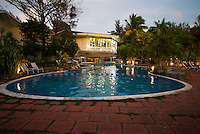 Honduras, Roatan Island, Fantasy Island Resort, Caribbean. Hotel pool and dining room in the evening.