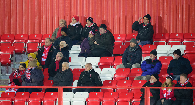 Lincoln City fans watch their team in action<br /> <br /> Photographer Andrew Vaughan/CameraSport<br /> <br /> The EFL Checkatrade Trophy Second Round - Accrington Stanley v Lincoln City - Crown Ground - Accrington<br />  <br /> World Copyright &copy; 2018 CameraSport. All rights reserved. 43 Linden Ave. Countesthorpe. Leicester. England. LE8 5PG - Tel: +44 (0) 116 277 4147 - admin@camerasport.com - www.camerasport.com