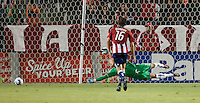 Revolution goalie Matt Reis (1) dives for the goal shot by Chivas midfielder Paulo Nagamura during the first half of the game between Chivas USA and the New England Revolution at the Home Depot Center in Carson, CA, on September 10, 2010. Chivas USA 2, New England Revolution 0.