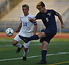 Savvas Christoforou #10 of Port Washington, left, pressures Frank Schmidt #9 of Massapequa during the Nassau County varsity boys soccer Class AA final at Mitchel Athletic Complex in Uniondale on Wednesday, Oct. 31, 2018. Christoforou scored the lone goal early in the second half to lead Port Washington to a 1-0 win.