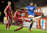 Aberdeen v St Johnstone...01.01.15   SPFL<br /> Simon Lappin is tackled by Shaleum Logan<br /> Picture by Graeme Hart.<br /> Copyright Perthshire Picture Agency<br /> Tel: 01738 623350  Mobile: 07990 594431