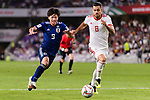 Morteza Pouraliganji of Iran (R) fights for the ball with Minamino Takumi of Japan (L) during the AFC Asian Cup UAE 2019 Semi Finals match between I.R. Iran (IRN) and Japan (JPN) at Hazza Bin Zayed Stadium  on 28 January 2019 in Al Alin, United Arab Emirates. Photo by Marcio Rodrigo Machado / Power Sport Images