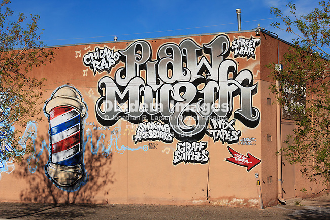 Graffiti advertisement for Raw Muzik shop, Albuquerque, New Mexico.