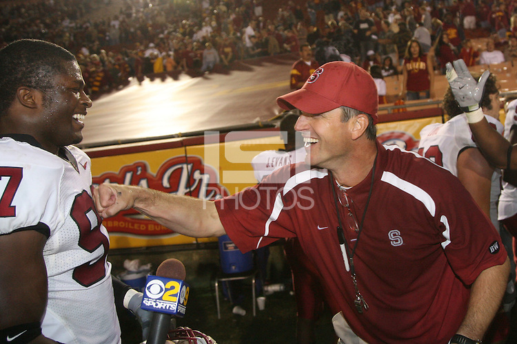 6 October 2007: Emmanuel Awofadeju and Jim Harbaugh after Stanford's 24-23 win over the #1 ranked USC Trojans in the Los Angeles Coliseum in Los Angeles, CA.