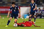 Haraguchi Genki of Japan (L) fights for the ball with Harib Al Saadi of Oman (R) during the AFC Asian Cup UAE 2019 Group F match between Oman (OMA) and Japan (JPN) at Zayed Sports City Stadium on 13 January 2019 in Abu Dhabi, United Arab Emirates. Photo by Marcio Rodrigo Machado / Power Sport Images