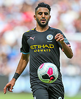 Riyad Mahrez of Manchester City during the Premier League match between West Ham United and Manchester City at the London Stadium, London, England on 10 August 2019. Photo by David Horn.