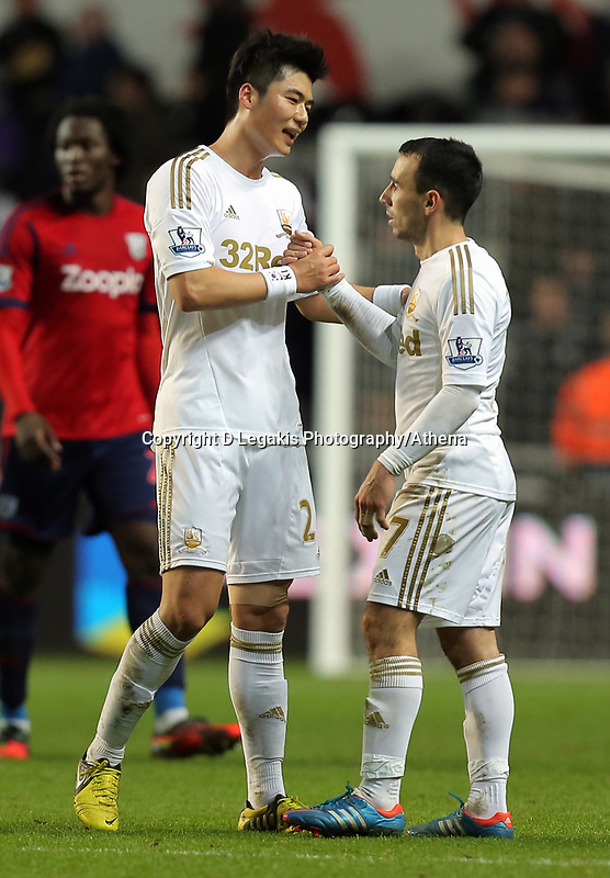 Sunday, 28 November 2012<br /> Pictured: (L-R) Ki Sung-Yueng and Leon Britton.<br /> Re: Barclays Premier League, Swansea City FC v West Bromwich Albion at the Liberty Stadium, south Wales.