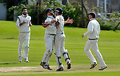 Cricket Scotland Scottish Cup Final - Watsonians CC V Heriots CC at Titwood - Glasgow - a wicket celebration for Heriots capt Steve Knox (centre left) with his keeper Brad Kneebone - fielders are Ali Farooq (left) and Craig Adams - 02.9.12 - 07702 319 738 - clanmacleod@btinternet.com - www.donald-macleod.com