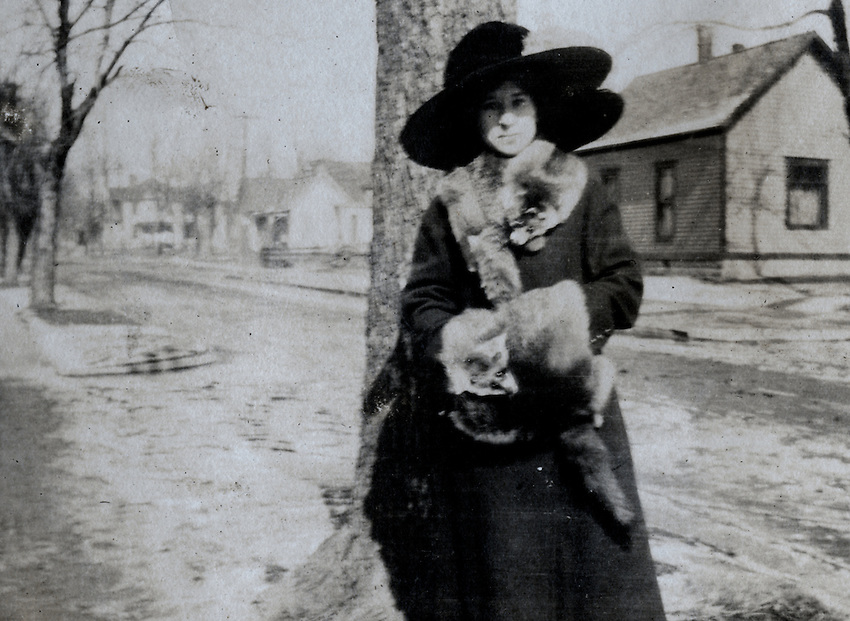 UPDATE: 90% certain that this is Josephine Thornburg Martin who was grandmother to all the Weis kids here in Moberly. She was Alberta Martin Weis' mother, and Molly Weis McGovern remembers that Alberta had the little foxes in her cedar chest. Josephine was the widow of Albert Martin who worked at the post office and died of pneumonia in 1920 just before Alberta was born. The family lived on South 4th.  This picture was probably taken at the intersection of Williams & McKinsey.  I'll look for that 2-story house on my next trip to town.