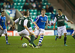 Hibs v St Johnstone.....11.02.13      SPL.Liam Craig is closed down by Paul Hanlon.Picture by Graeme Hart..Copyright Perthshire Picture Agency.Tel: 01738 623350  Mobile: 07990 594431