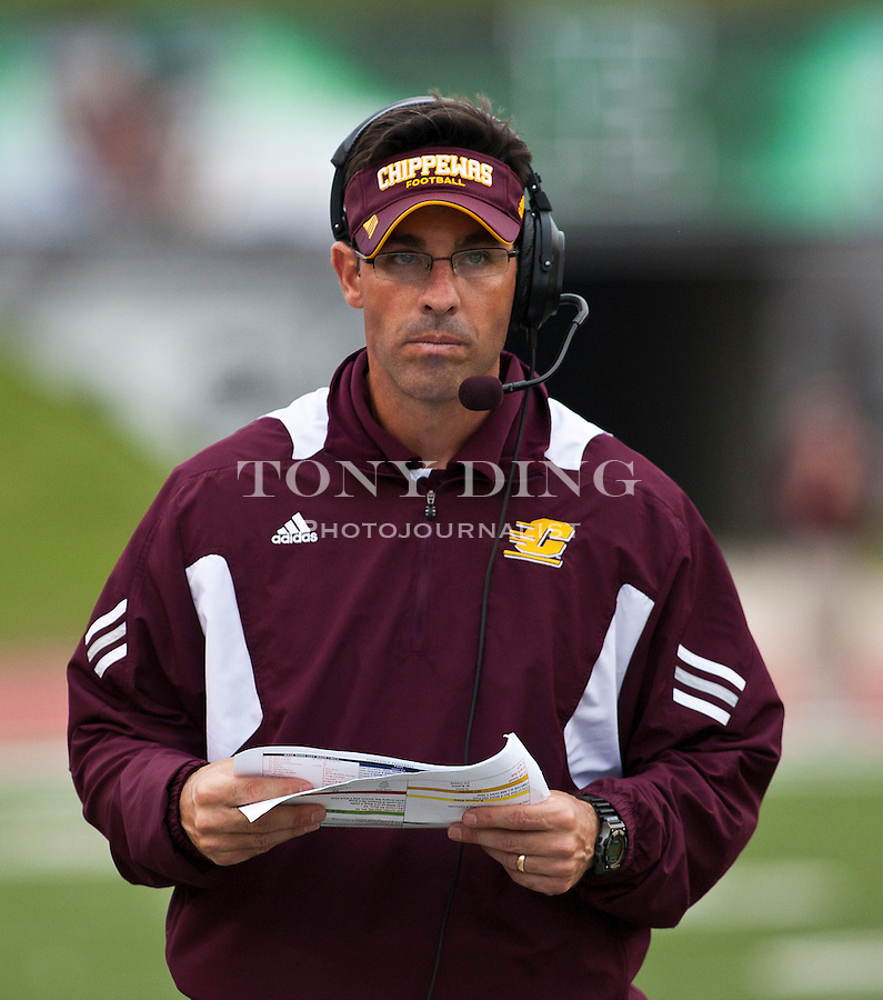 Central Michigan head coach Dan Enos listens on his headphones from the sideline in the fourth quarter of an NCAA college football game with Eastern Michigan, Saturday, Sept. 18, 2010, in Ypsilanti, Mich. Central Michigan won 52-14. (AP Photo/Tony Ding)