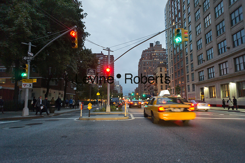 Traffic speeds down Ninth Avenue in the Chelsea neighborhood of New York on Thursday, October 18, 2012. (© Richard B. Levine)