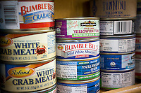 Cans of tuna and crabmeat in a grocery store in New York  on Saturday, May 17, 2014 (© Richard B. Levine)