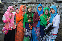 "Borobudur, Java, Indonesia.  Young Women from Surabaya Visiting the Temple.  The V is a common gesture in Indonesia when the person being photographed wants the photo to be a good one.  The raised thumb and straight index finger (lady on the left) means ""looking good."""
