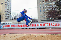 Krasnodar, Russia, 16/03/2009..World champion heptathlete Tatyana Chernova practicing long jumps at the stadium in her home city of Krasnodar. The slogan behind reads: The road to Olympic medals starts here. Chernova, who won bronze in the Beijing Olympic Games, is tipped for gold in the forthcoming London Olympics.