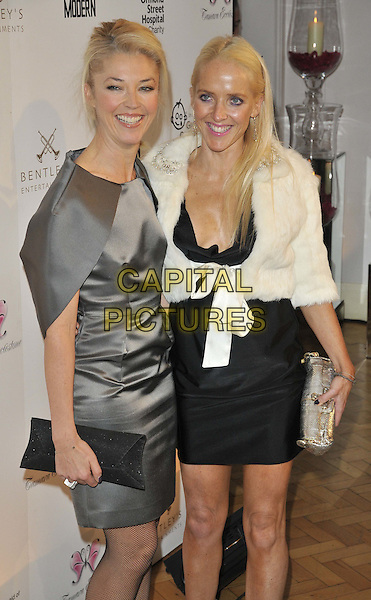 Tamara Beckwith & Clare Beckwith.Tamara Ecclestone's annual fundraising dinner in aid of Great Ormond Street Children's Hospital Charity at One Marylebone, London, England..November 14th 2011.half length silver grey gray silk satin dress black white fur knotted jacket clutch bag silver sisters siblings family .CAP/CAN.©Can Nguyen/Capital Pictures.