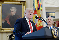 United States President Donald Trump speaks about trade as US Vice President Mike Pence looks on before signing Executive Orders  in the Oval Office of the White House March 31, 2017 in Washington, DC. Photo Credit: Olivier Douliery/CNP/AdMedia